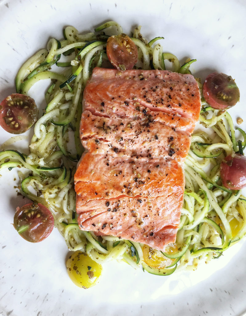 wild sockeye Alaskan salmon with farm fresh heirloom tomatoes and pesto noodles
